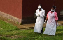 Two medical staff wear face masks at hospital.