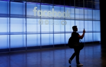 a man walks in a hallway at facebook