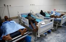 Wounded migrants lie on hospital beds after an air strike hit a detention center for mainly African migrants in Tajoura, in Tripoli Central Hospital, Libya, July 3, 2019.