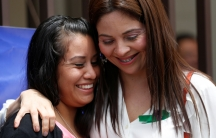 Evelyn Hernández, who was sentenced to 30 years in prison for a suspectedabortion, is hugged by a woman.
