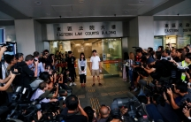 Pro-democracy activists Joshua Wong and Agnes Chow leave the Eastern Court after being released on bail in Hong Kong, China, on August 30, 2019.