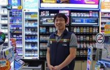 Man stands in 7-Eleven in work vest