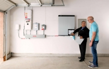 Homeowners can connect solar panels to batteries in their garage, this one from the Bay Area company Sunrun, to help power much of their homes during times of peak electricity demand.