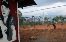 Former rebels of the Revolutionary Armed Forces ofColombia play football at a camp