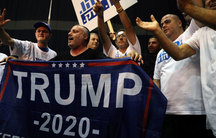 """Supporters of Israeli Prime Minister Benjamin Netanyahu's Likud party react to exit polls in Israel's parliamentary election at the party headquarters in Tel Aviv, Israel, on Sept. 17, 2019.  One sign says """"Trump 2020"""" as well."""