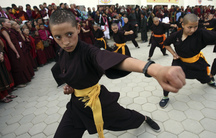A Buddhist nun with a shaved head takes part in aKung Fudisplay