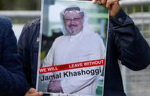 """A man holds a sign that says """"we will not leave without Jamal Khashoggi"""""""