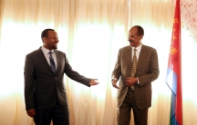 Eritrea's President, Isaias Afwerki, talks to Ethiopia's Prime Minister, Abiy Ahmed during the Inauguration ceremony marking the reopening of the Eritrean Embassy in Addis Ababa, Ethiopia, on July 16, 2018.