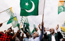 People carry Pakistan's andAzadKashmir's green flags and chant slogans to express solidarity with the people ofKashmir, in Karachi, Pakistan,August 30, 2019.