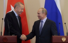 Russian President Vladimir Putin, right,shakes hands with Turkish President Recep Tayyip Erdogan, left,during their joint news conference following Russian-Turkish talks in the Black sea resort of Sochi, Russia, on October 22, 2019.