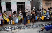 People wait in line to get water in Port-au-Prince, Haiti, on September 29, 2019.