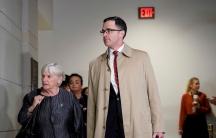 A tall white man and a shorter white woman walking
