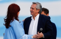 Argentina's presidential candidate Alberto Fernández and his running mate former President Cristina Kirchner embrace each other during a closing campaign rally in Mar del Plata,Argentina, Oct.24, 2019.