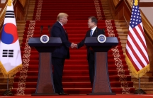 US President Donald Trump, left, greets South Korean President Moon Jae-in during a joint news conference at the presidential Blue House on June 30, 2019 in Seoul, South Korea.