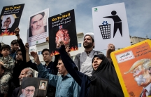 Iranians shout slogans during a protest