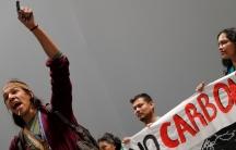 A man raises his left arm in protest.