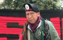 Jose Albeiro Camayo is show in a close-up photograph wearing a red beret.