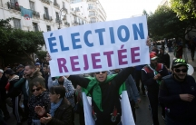 Demonstrators shout slogans during a protest to reject the presidential election in Algiers,Algeria, Dec. 12, 2019.