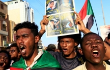 Sudanese protesters chant slogans during a rally calling for the former ruling party to be dissolved and for ex-officials to be put on trial in Khartoum, Sudan, Oct. 21, 2019.