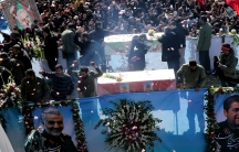 Iranian people attend a funeral procession and burial for Iranian Major-General Qasem Soleimani, head of the elite Quds Force, who was killed in an airstrike at Baghdad airport, at his hometown in Kerman, Iran, Jan.7, 2020.