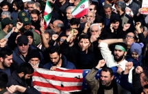Demonstrators with Iranian and American flags.