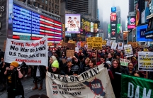 People march as they take part in an anti-war protest