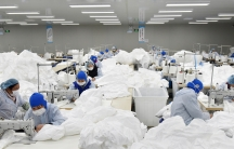 Workers make protective suits at a factory, as the country is hit by an epidemic of the newcoronavirus, in Chaohu, Anhui province, China.