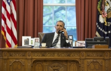 US President Barack Obama talks with Iranian President Hasan Rouhani during a phone call in the Oval Office September 27, 2013. REUTERS/Pete Souza/The White House