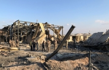 Rubble and exposed I-beams are shown after the Ain al-Asad air base in Iraq was bombed.