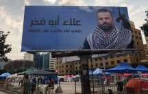 Vendorsand civil society tents set up in Martyrs' Square under the photo of man who was killed during a roadblock in a suburb of Beirut.