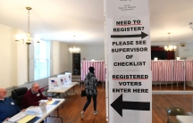 Signs direct voters at a polling place in the state's presidential primary election in Greenfield, New Hampshire, Feb.11, 2020.