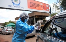 A health worker screens and sanitises visitors to prevent the spread of coronavirus disease (COVID-19) outside a hospital in Harare,ZimbabweMarch 26, 2020.