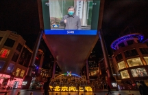 A screen shows a CCTV state media broadcast of Chinese President Xi Jinping's visit toWuhanat a shopping centre in Beijing as the country is hit by the outbreak of the novel coronavirus, China, March 10, 2020.