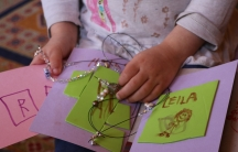 """The author's 3-year-old daughter Leila has been occupying herself during the """"stay at home"""" order in Boston amid the coronavirus outbreak by making cards and beaded necklaces for her preschool friends."""