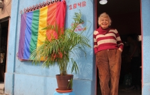 Samantha Flores, a trans woman, stands at the entrance to the Vida Alegre, a day center for older LGBTQ people in Mexico City that she cofounded.