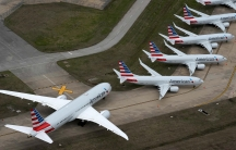 American Airlines passenger planes parked due to flight reductions made to slow the spread of coronavirus disease (COVID-19), at Tulsa International Airport in Tulsa, Oklahoma, on March 23, 2020.