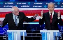 Senator Bernie Sanders speaks as former Vice President Joe Biden reacts during the ninth Democratic 2020 U.S. Presidential candidates debate at the Paris Theater in Las Vegas Nevada, on Feb. 19, 2020.