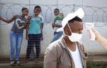 A health worker checks a man's temperature during door to door screening in an attempt to contain the coronavirus disease (COVID-19) outbreak in Jika Joe informal settlement in Pietermaritzburg, South Africa, April 16, 2020.