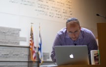 RabbiDaniel Schwartz reviews notes on his computer before getting ready to livestream a Friday night Shabbat service from inside Temple Shir Shalom, a Reform synagogue in West Bloomfield Township, Michigan, on March 27, 2020 amid a coronavirus disease (C