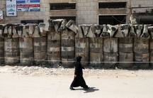 A woman walks inside a medical center that deals with coronavirus disease (COVID-19) testing in Idlib,Syria, April 13, 2020.