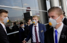 US members of The Church of Jesus Christ ofLatter-daySaints, wearing protective masks, gather at Toncontin International airport before heading home, as the coronavirus disease (COVID-19) outbreak continues, in Tegucigalpa, Honduras, March 29, 2020.