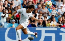 An action shot of a woman playing soccer