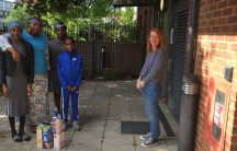 Fi Carrick-Davies poses with Bola Fagbemi and her children Fathia, Aishat and Abdul-Qayyum Akintoyese after dropping off some food for them. Carrick-Davies and the family are extremely close.