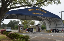 The main gate at Naval Air Station Pensacola is seen on Navy Boulevard in Pensacola, Florida, March 16, 2016.