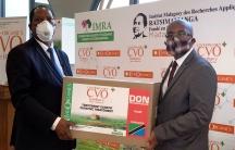 Palamagamba Kabudi, Tanzania's Foreign Minister receives a package from his Madagascar counterpart Tehindrazanarivelo Djacoba of the COVIDOrganics