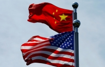Chinese and US flags flutter