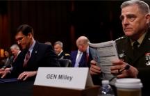 Gen. Milley and Sec. Esper sit at a table