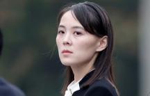 Kim Yo-jong is shown looking over her left shoulder