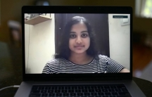 A young woman on a laptop screen