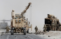 A photo of troops and military vehicles